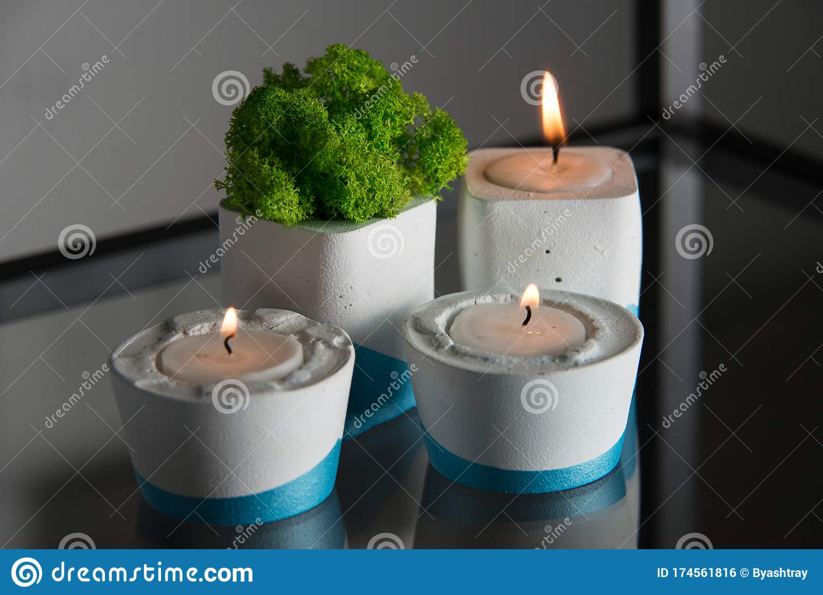 Candles And Moss In White And Blue Concrete Candle Holders Stock Photo Image Of Design Tealight 174561816