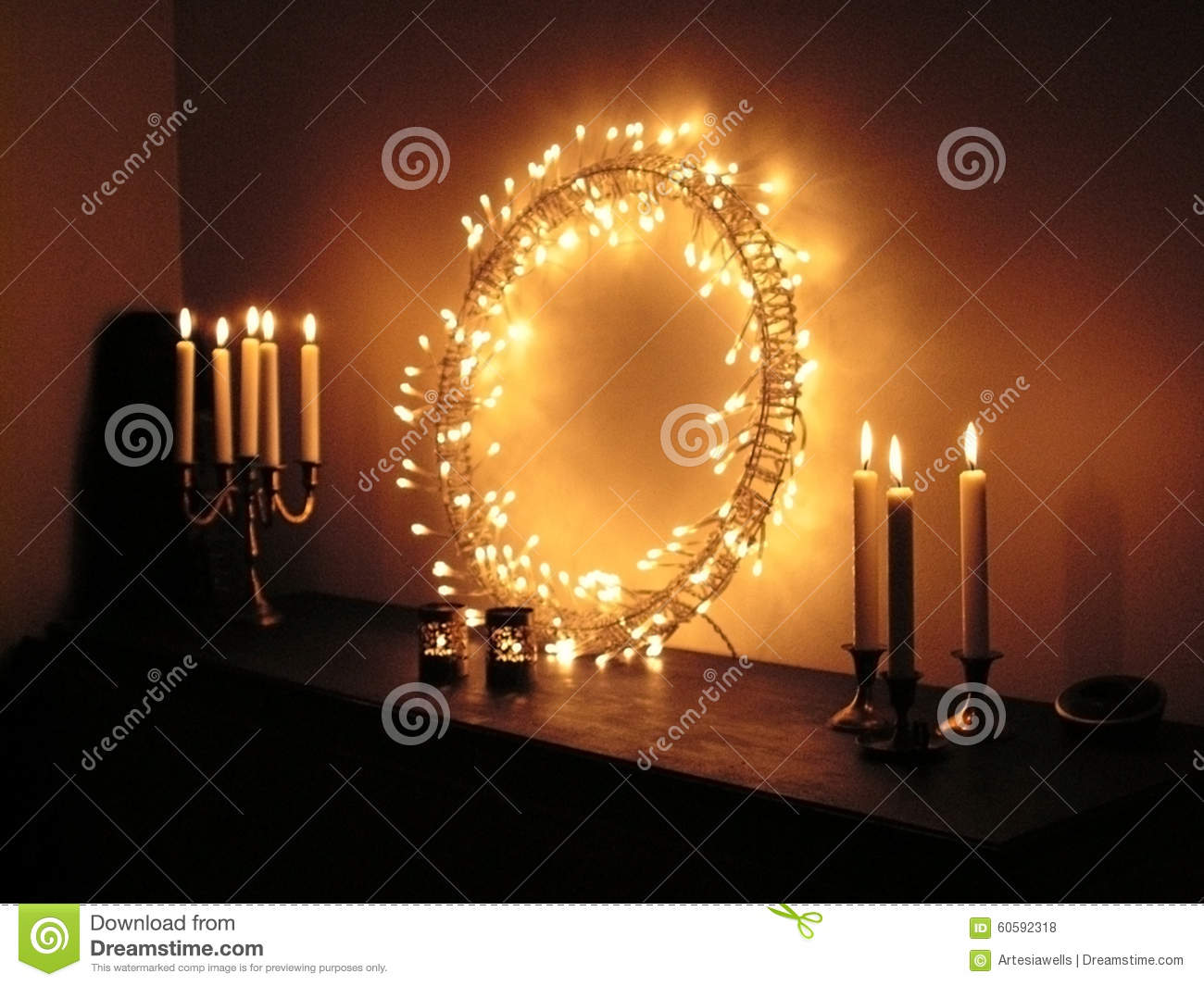 Candles and ring with light