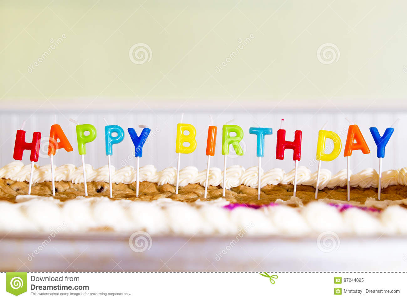Stupendous Candles Spelling Happy Birthday Sticking In A Cookie Cake Stock Personalised Birthday Cards Veneteletsinfo
