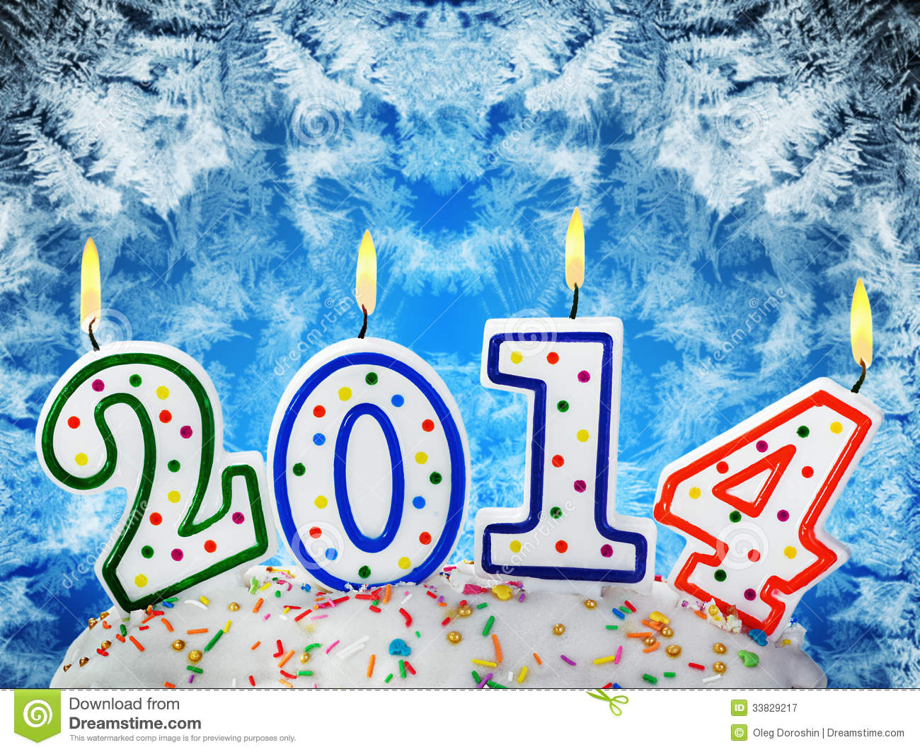 Stock Photography: Candles with the symbol of the new year on the cake ...