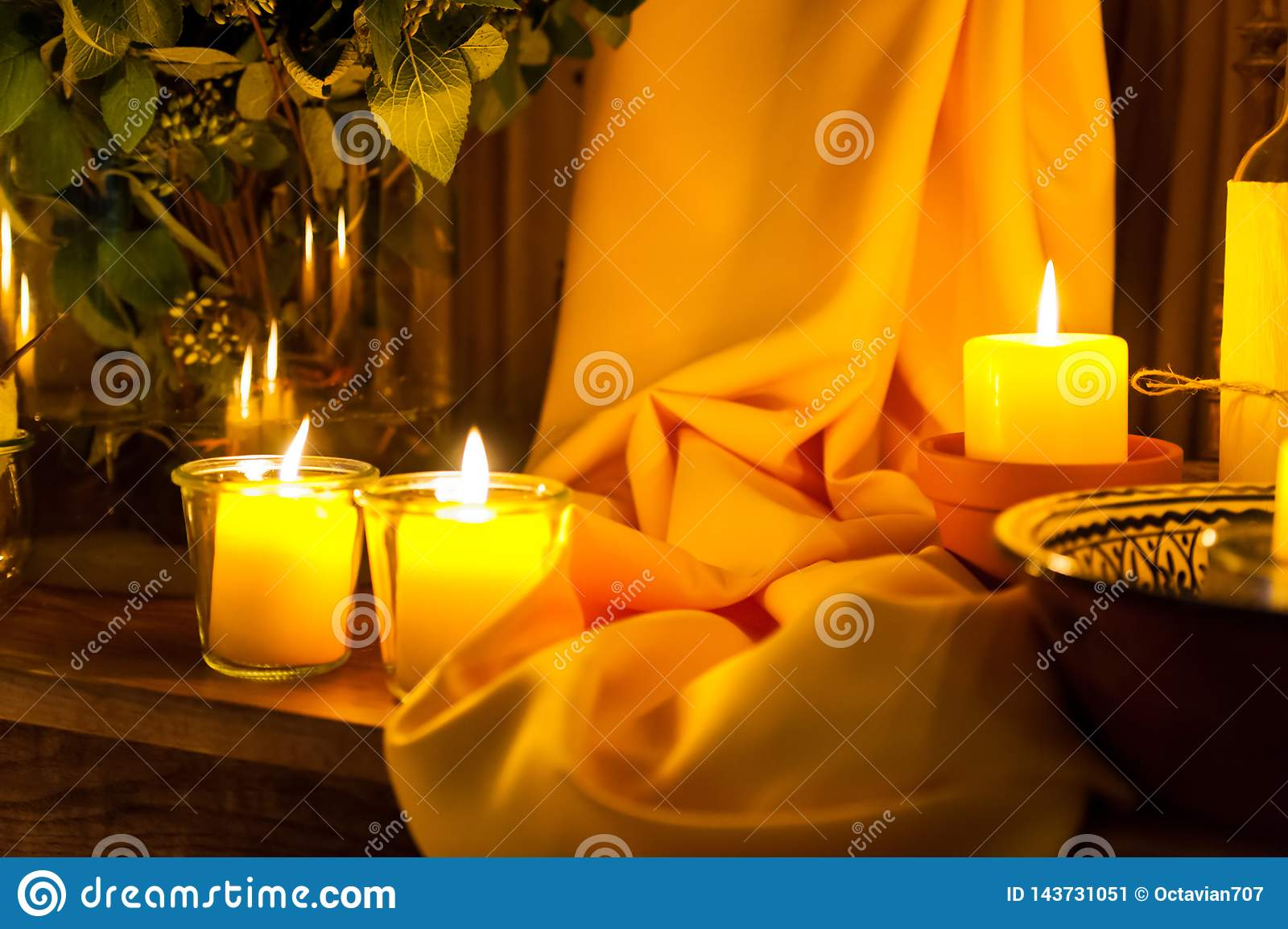 Candles and yellow fabric ornament