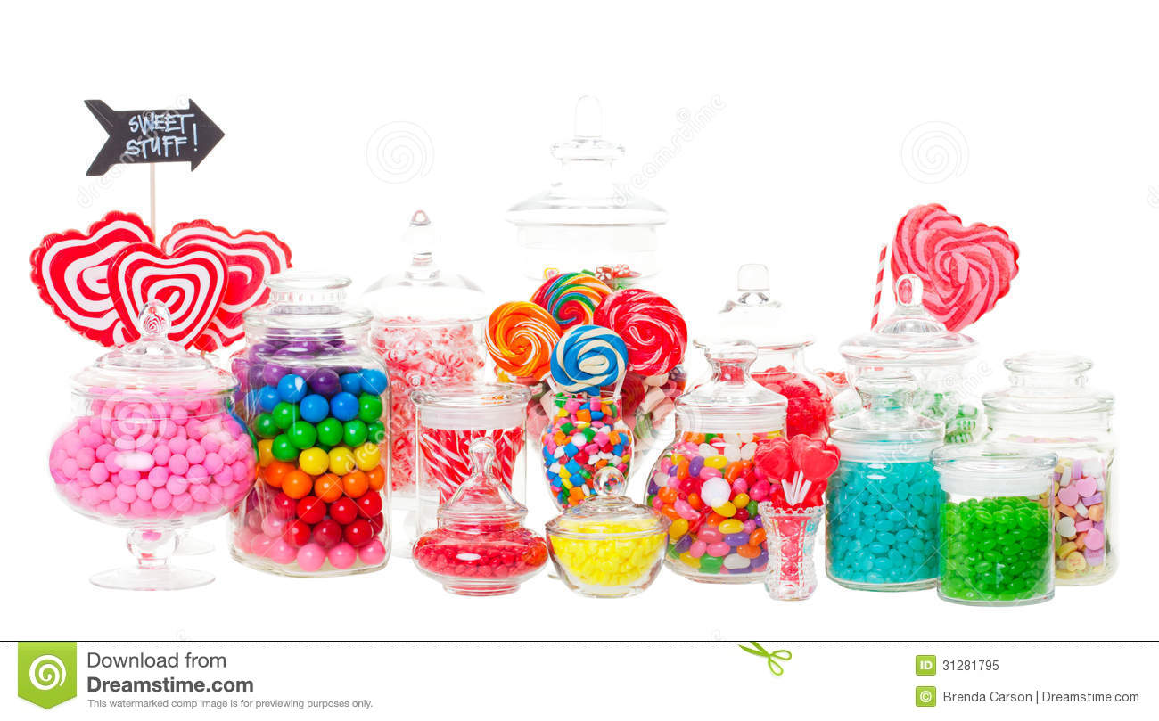 candy buffet with a wide variety of candies in apothecary jars. Shot ...
