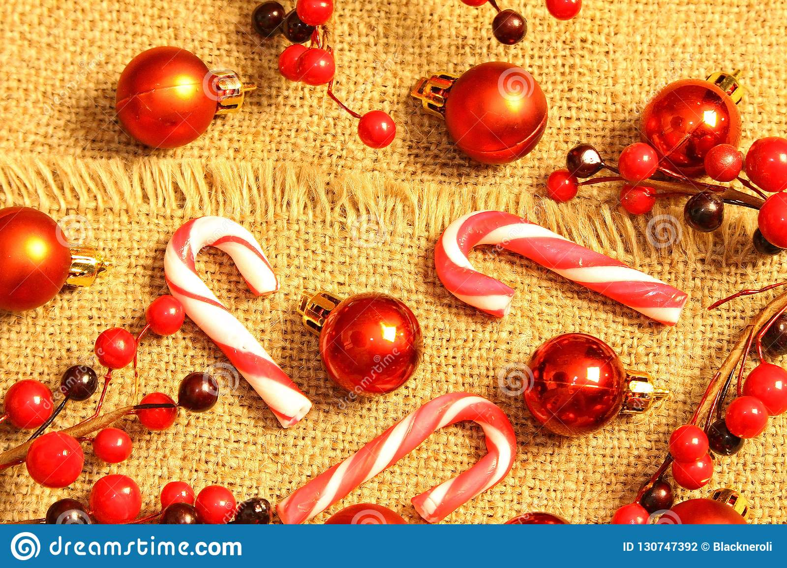 Christmas composition. Gifts, red decorations on linen background. Christmas, winter, new year concept. Flat la