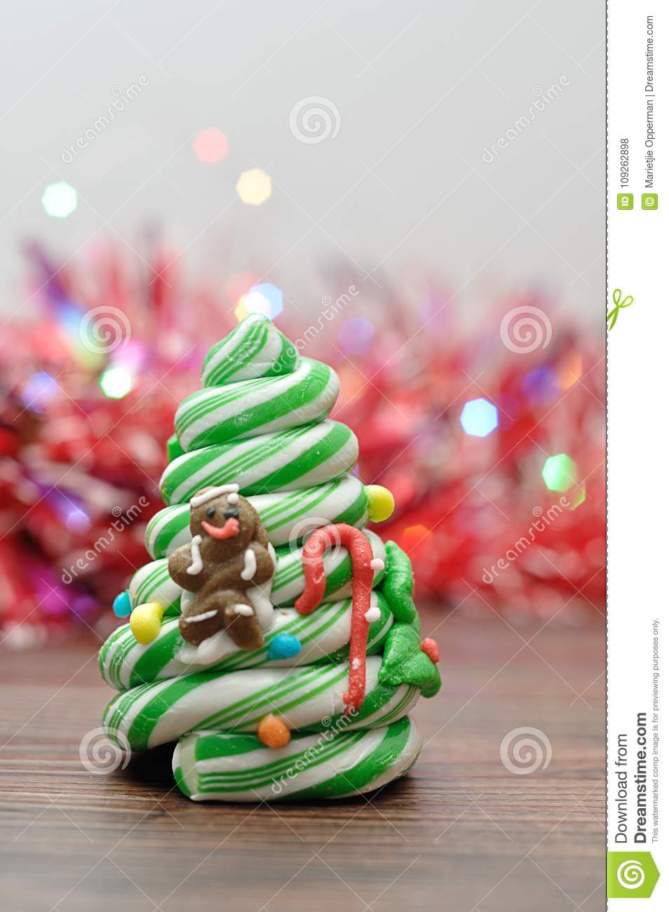 download a candy cane christmas tree with out of focus tinsel and lights stock photo - Candy Cane Christmas Tree