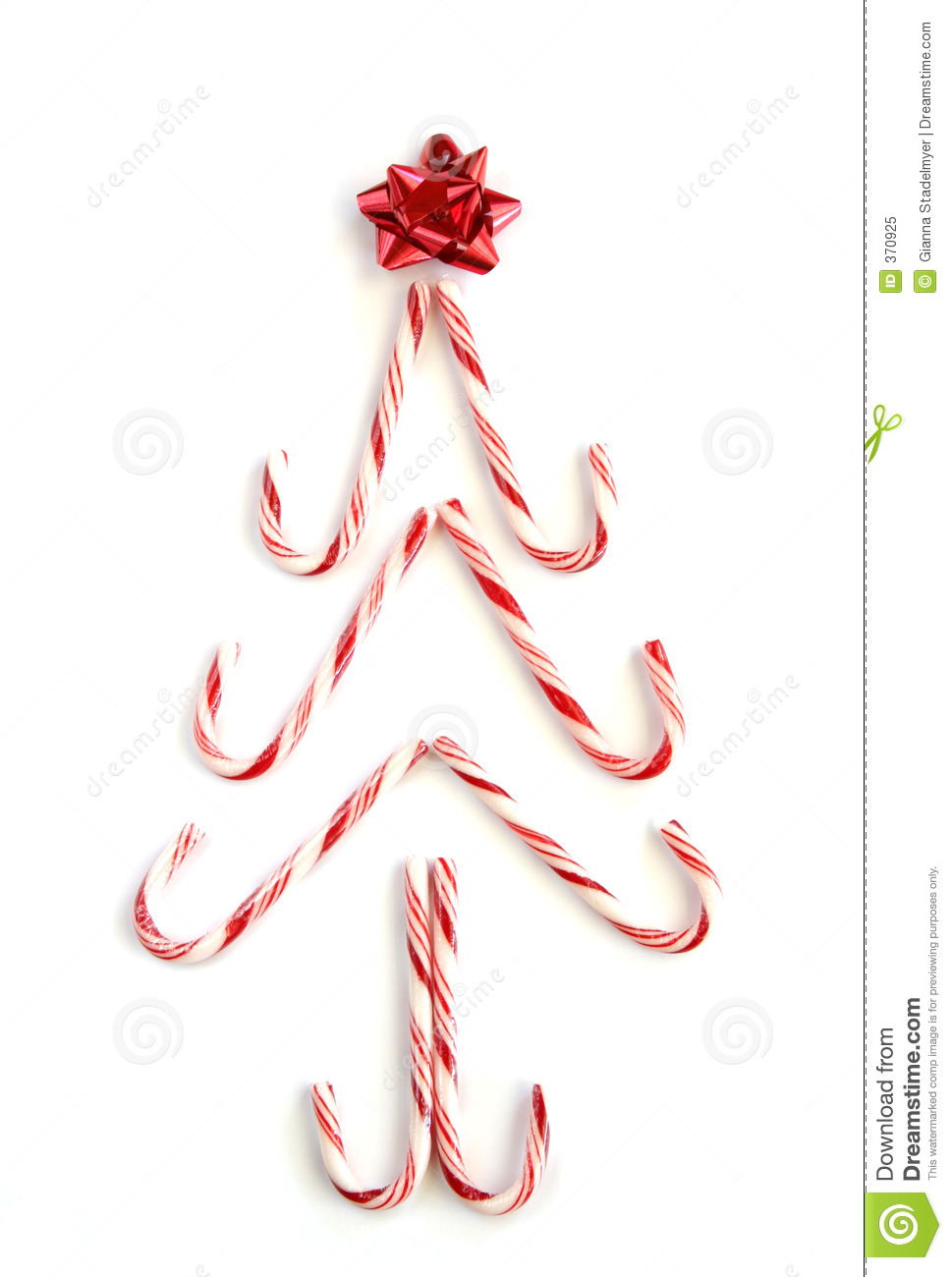 Candy canes form a Christmas tree with a shiny bow as the star. Also ...