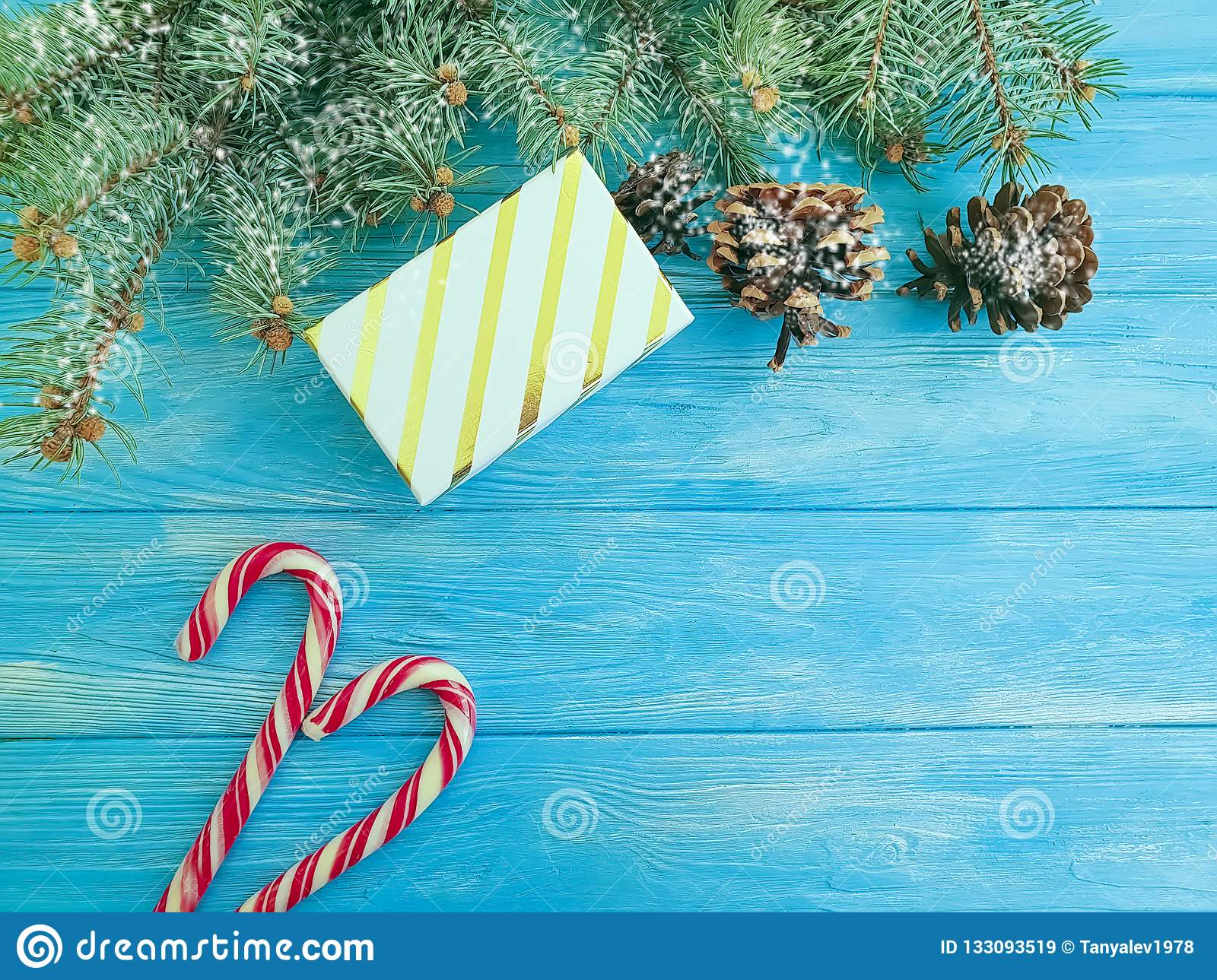 Candy Christmas Tree Branch Festive Decoration Border Present Snow Gift Box On A Blue Wooden Background Present Stock Image Image Of Festive Border 133093519