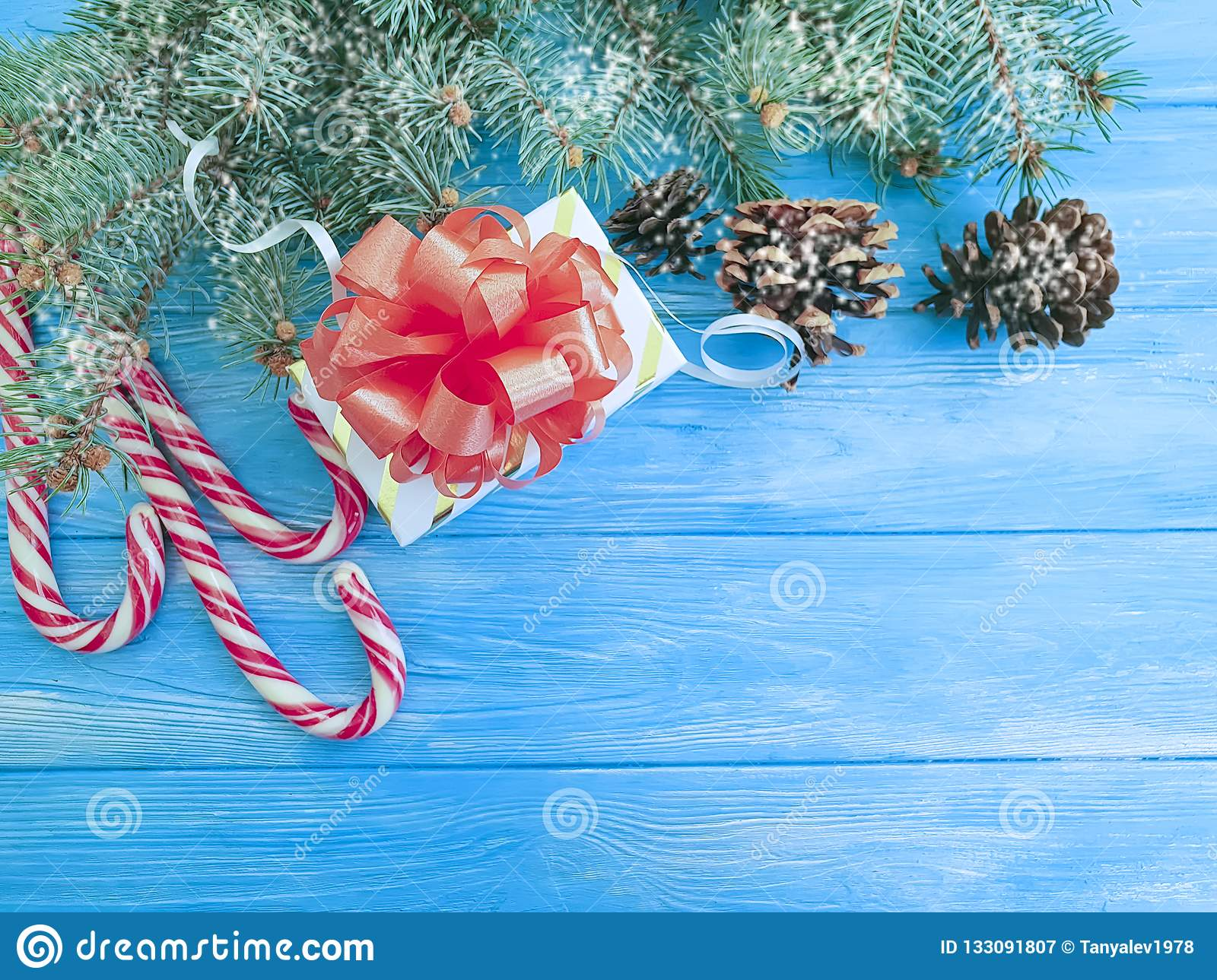 Candy Christmas Tree Branch Vintage Festive Decoration Border Present Snow Gift Box On A Blue Wooden Background Present Stock Image Image Of Snow Copy 133091807