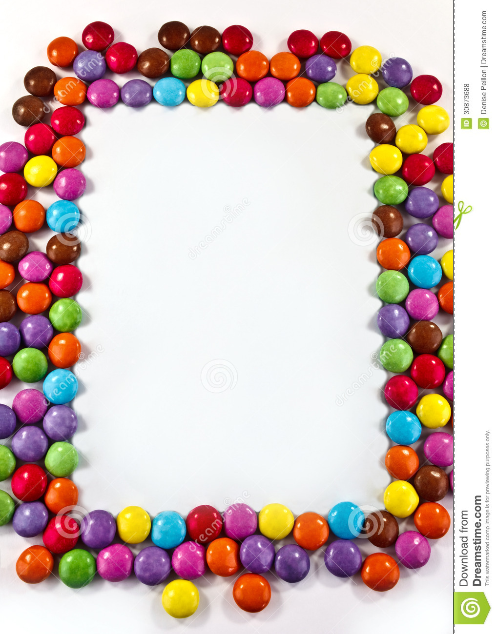 frame of colorful sugar coated chocolate smarties with space for ...
