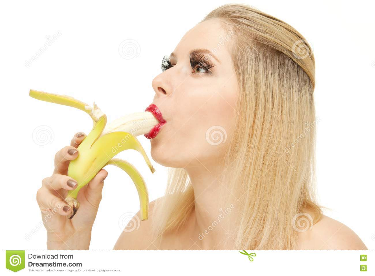 Candy Girl Sucking A Banana Royalty Free Stock Images