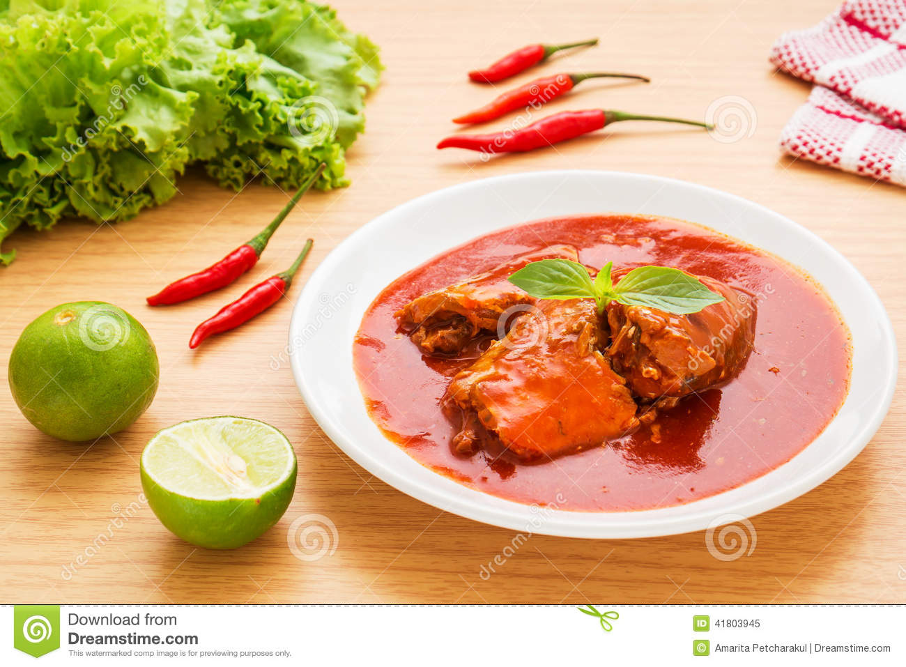 Canned fish in tomato sauce on plate stock photo image for Fish in tomato sauce