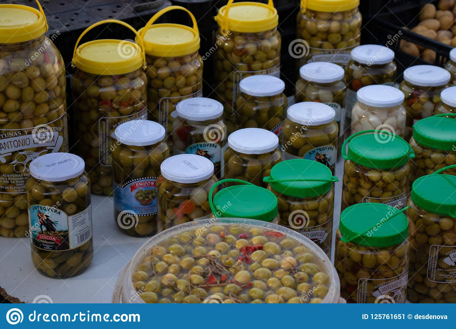 Canned green olives lined up