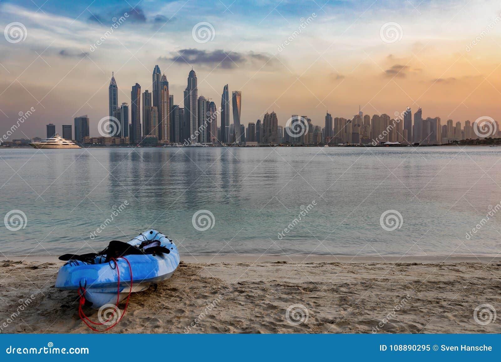 Canoe on the beach in front of the Dubai Marina