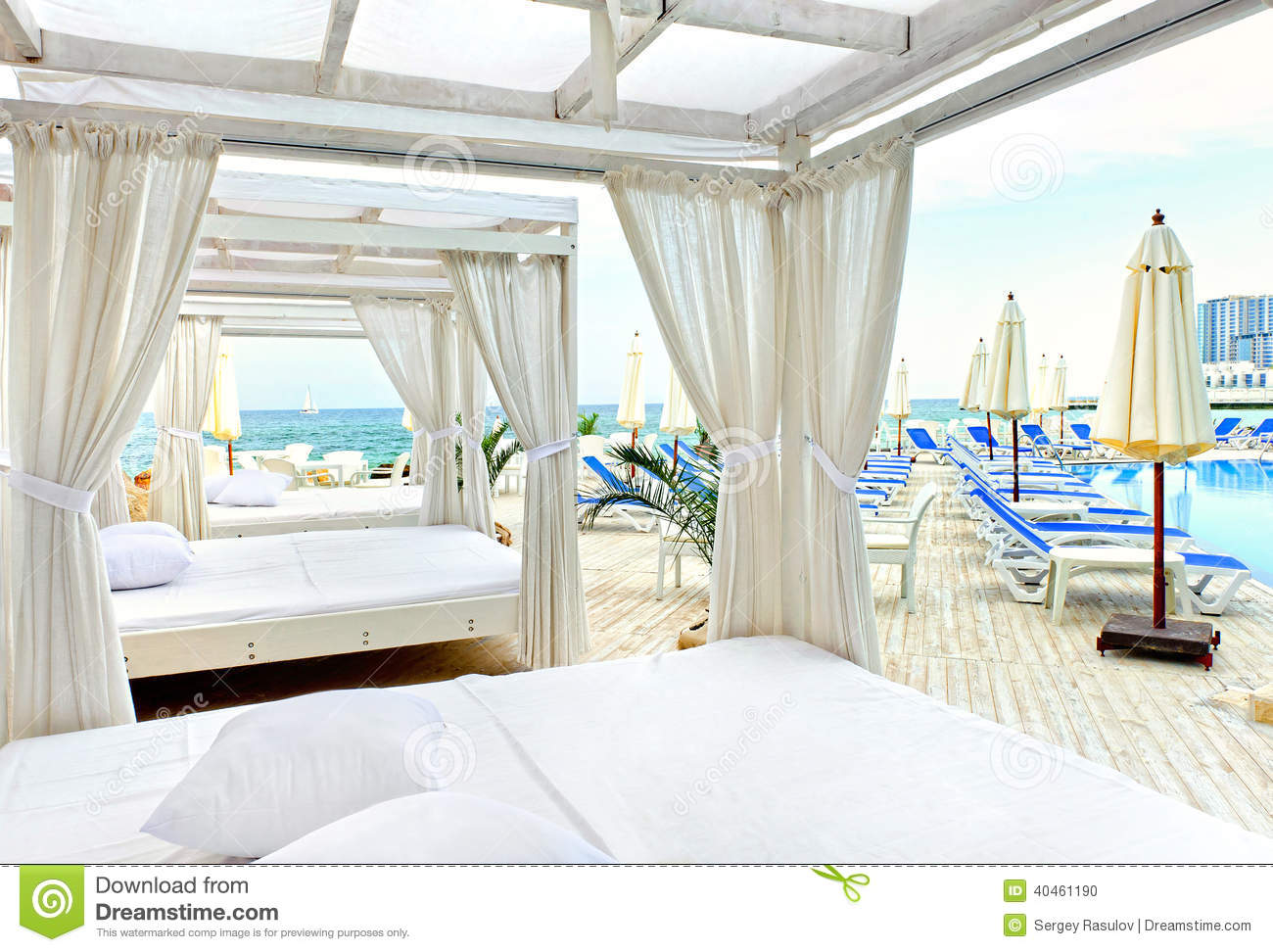 Canopy bed in beach stock photo image of resort pool for Pool canopy bed