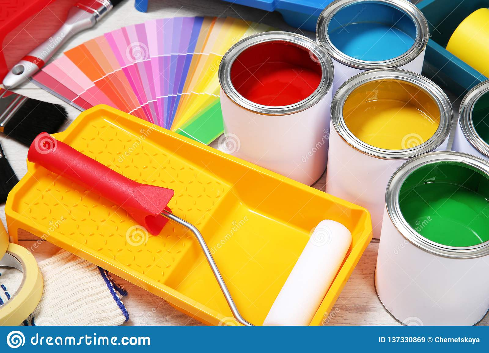 Cans of paint and decorator tools