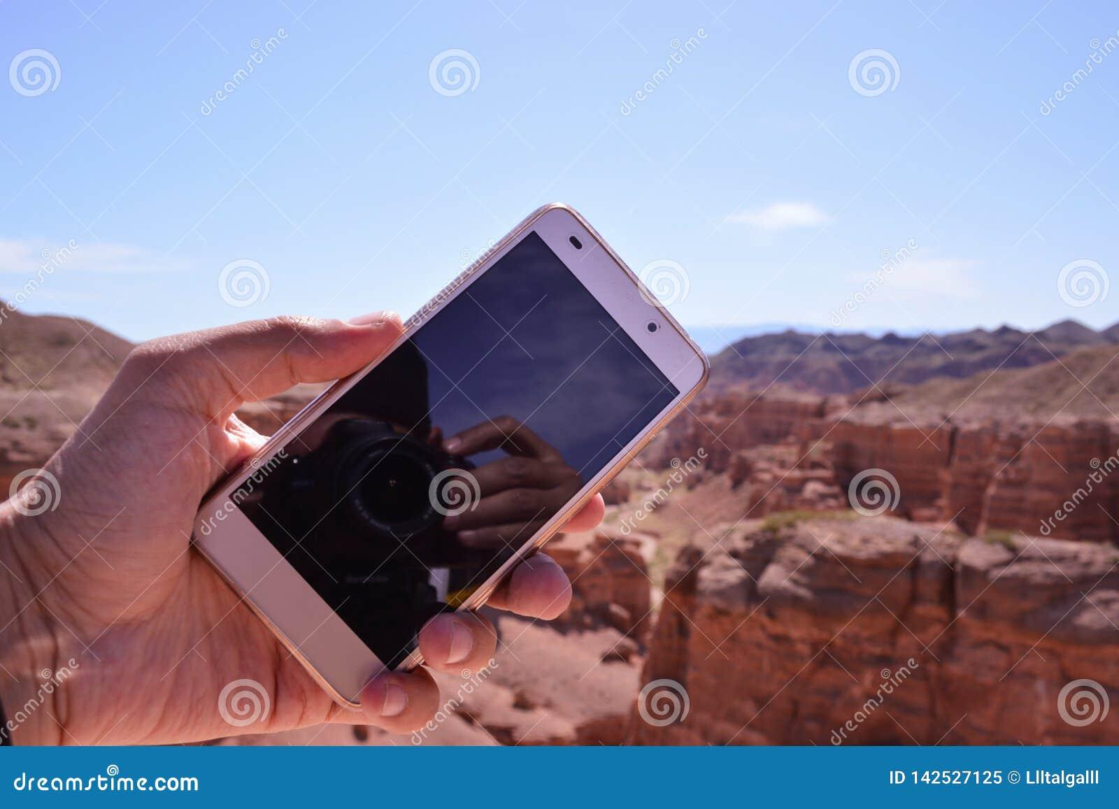 Phone on hand. Charyn canyon.