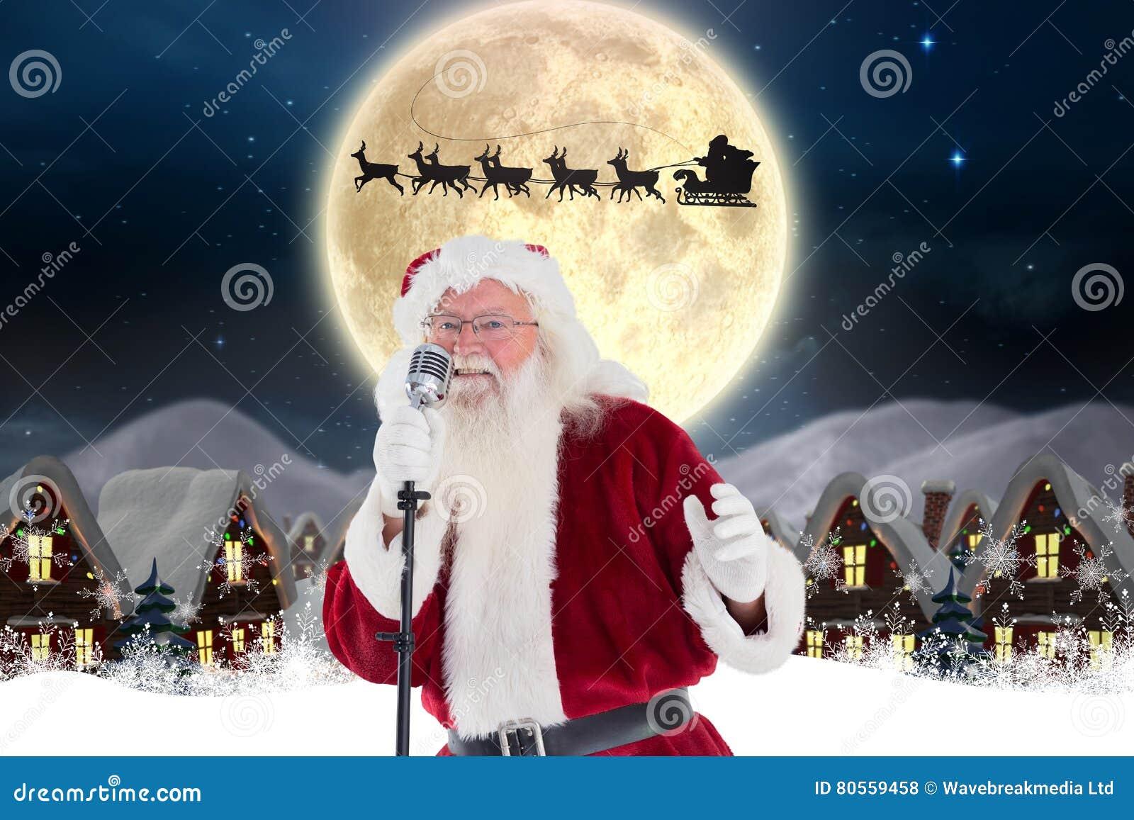 Babbo Natale Canzone.Canzone Di Natale Di Canto Del Babbo Natale In Microfono Fotografia