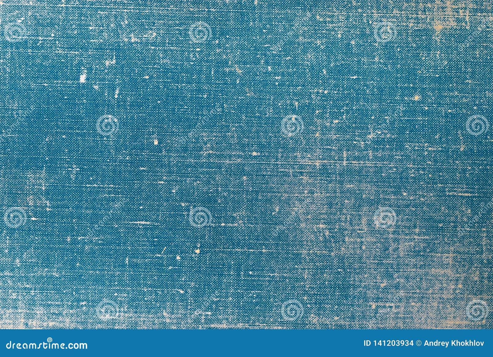 Capa do livro de pano do vintage com um teste padrão da tela azul e as texturas do fundo do grunge