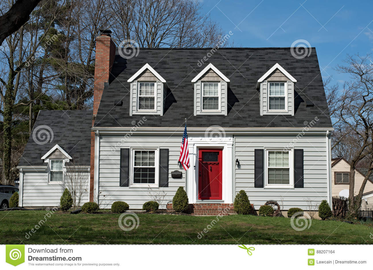 Cape Cod House With Three Dormers Amp Red Door Stock Photo