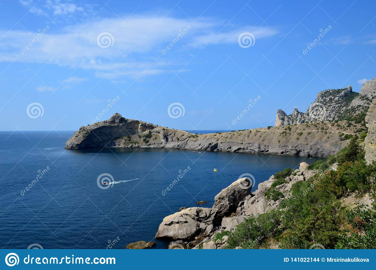Cape Kapchik in the Black Sea near the village of Novy Svet sunny summer day. Mountain in the form of a dolphin, side view