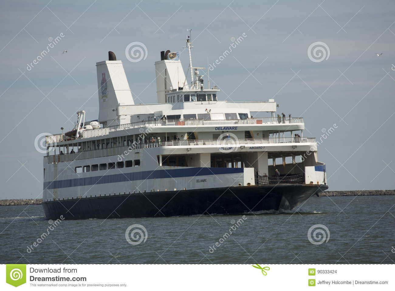 cape may ferry boat turns into dock at lewes, delaware. editorial