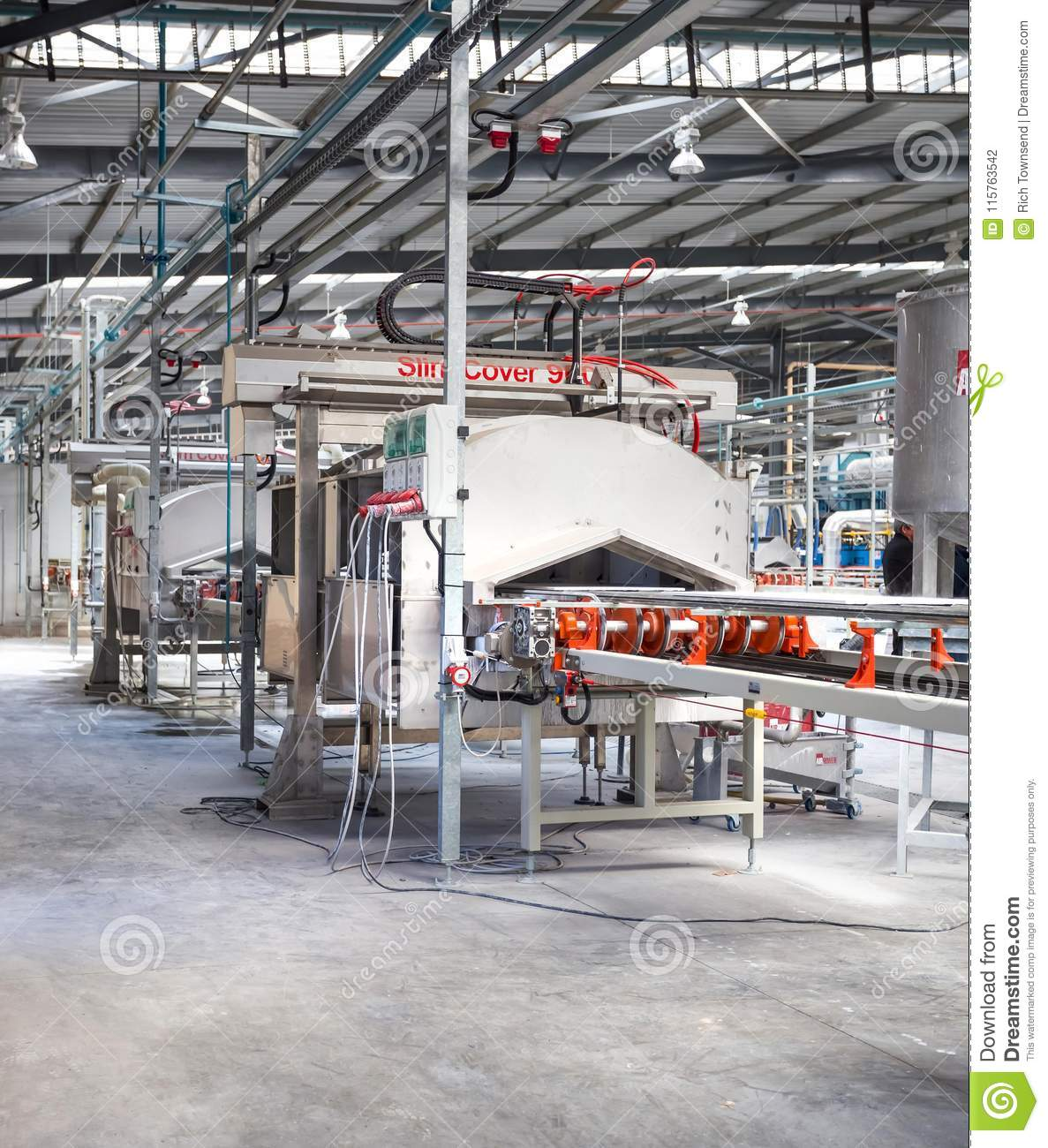 Ceramic tile manufacturing plant with a conveyer belt.