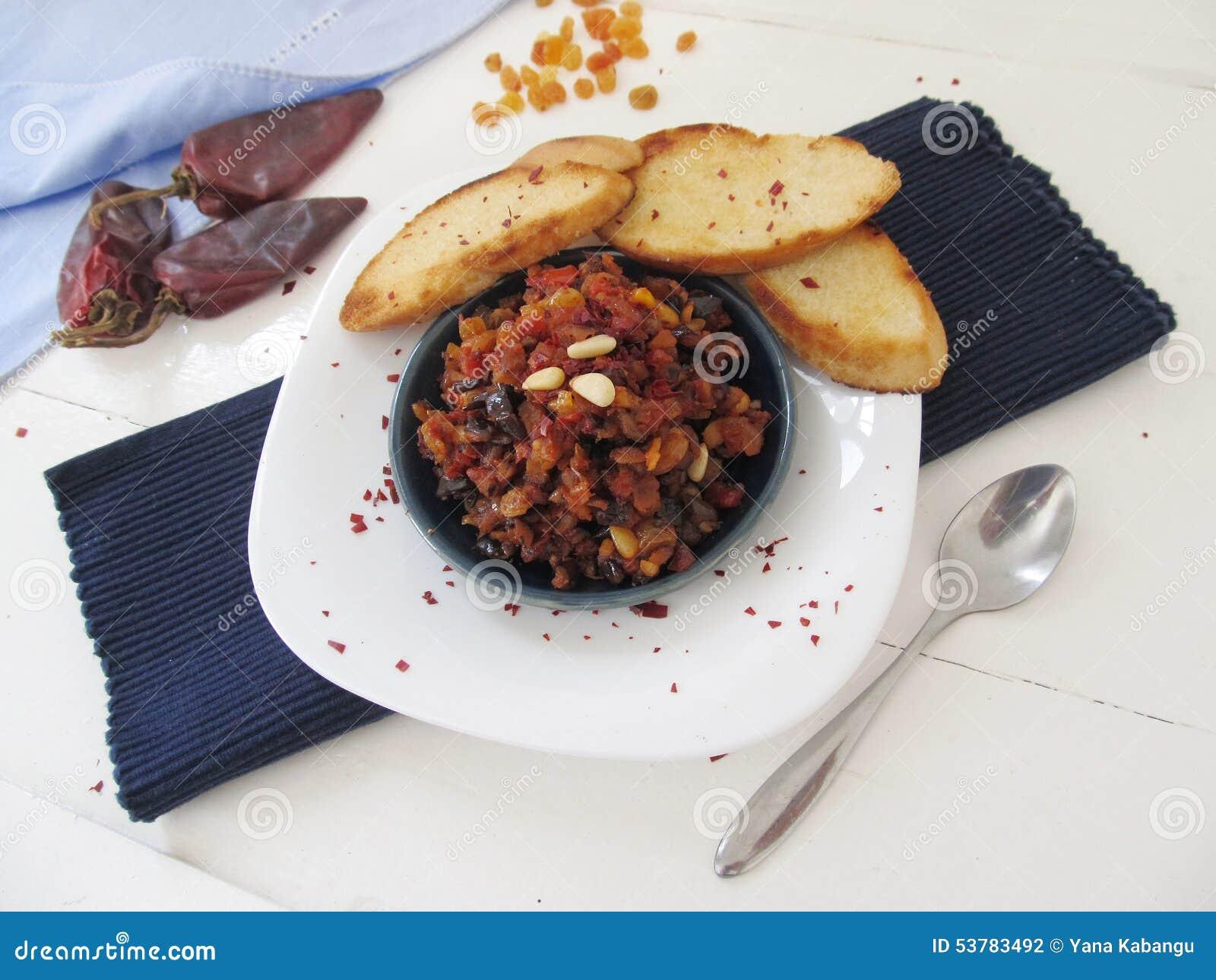 Caponata - eggplant relish with tomatoes, onion, pine nuts and raisins ...