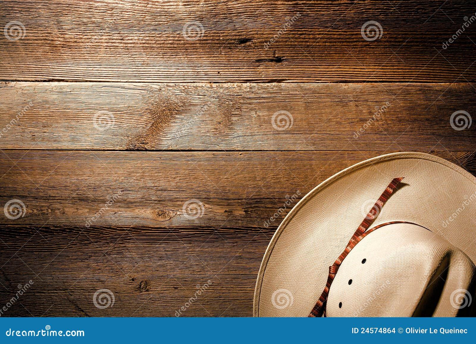 Cappello ad ovest americano del cowboy del rodeo su priorità bassa di legno