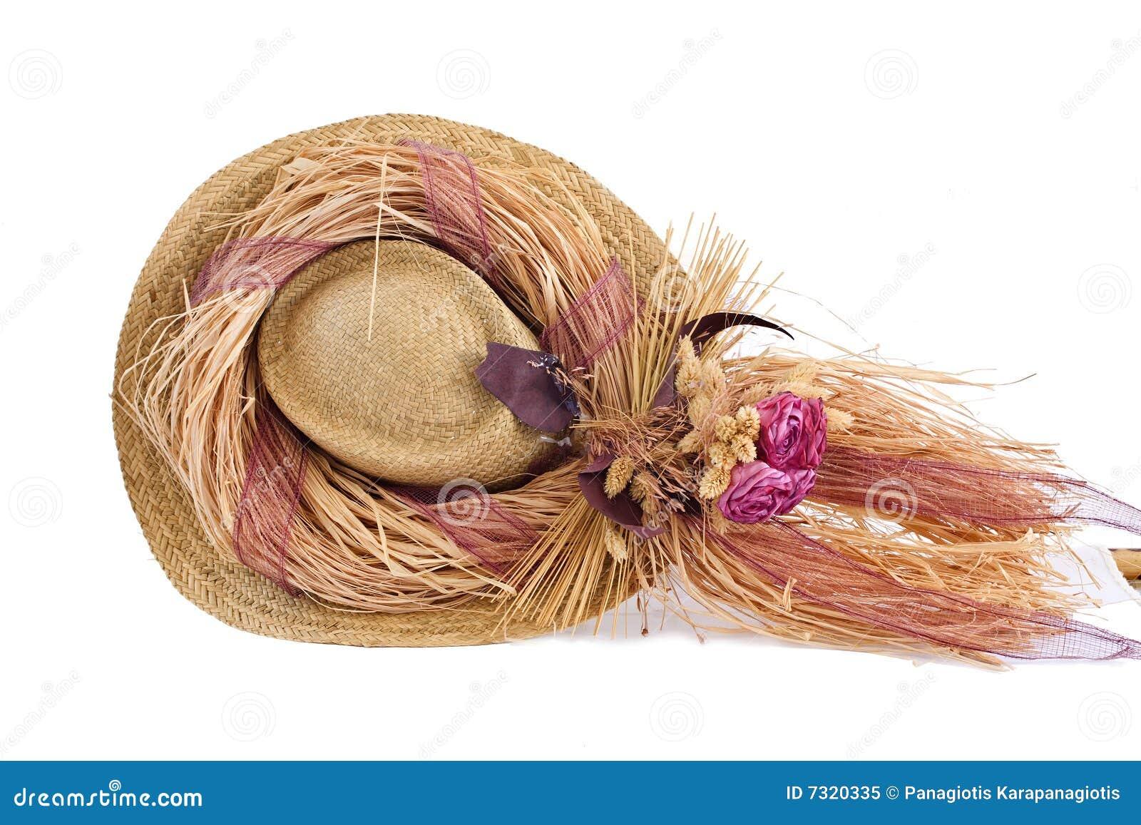Cappello decorativo con i fiori falsi in cima esso