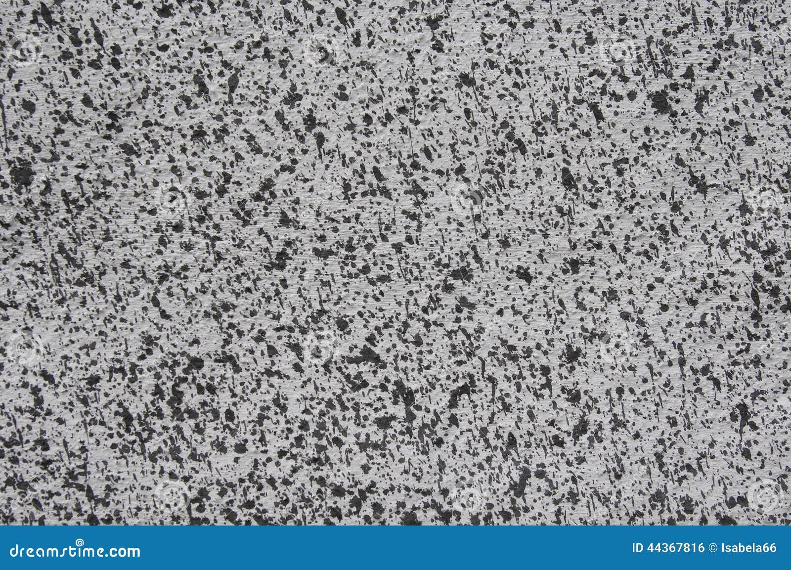 Cappotto grigio con il primo piano dei punti neri