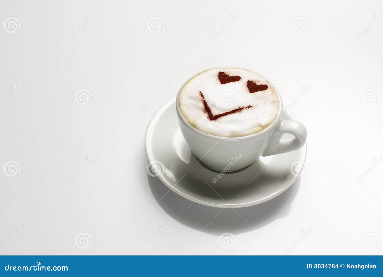 Cappuccino s met gezicht in melk