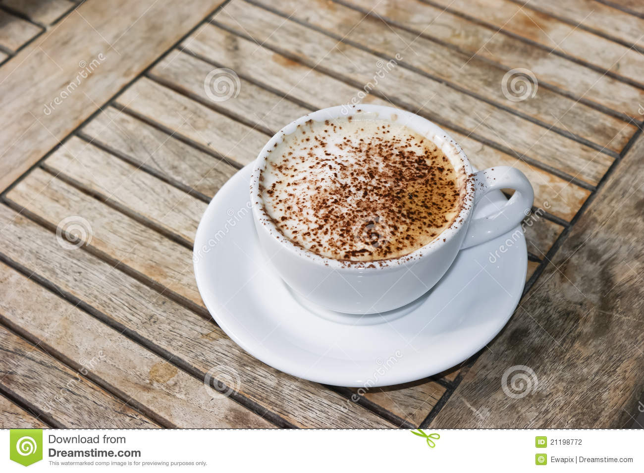 Cappuccino on wooden table