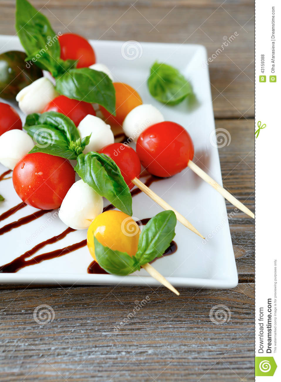 Caprese salad on wooden sticks