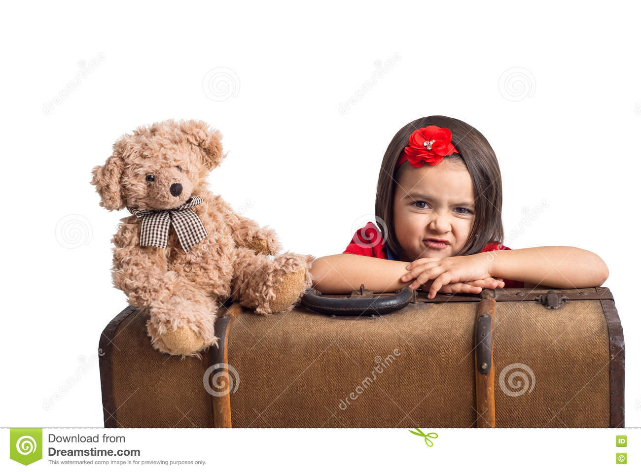 Capricious little Girl with suitcase and toy bear