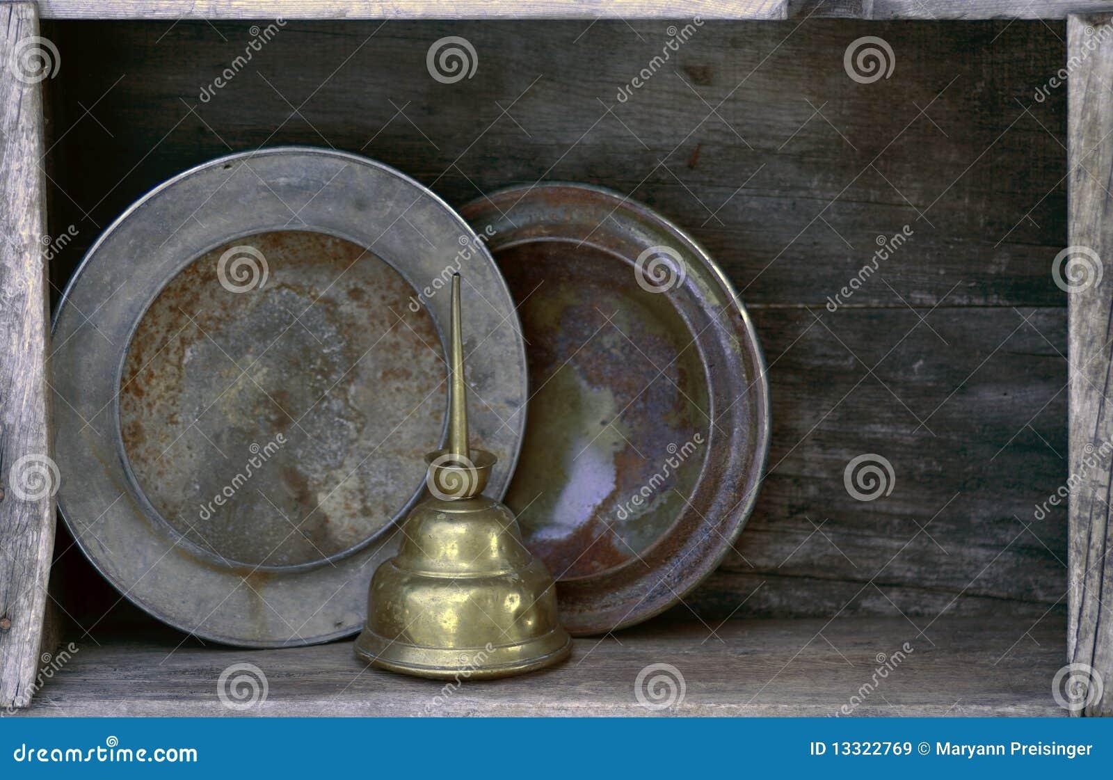 Caps navhubcaps som oljekannan rostade hyllan