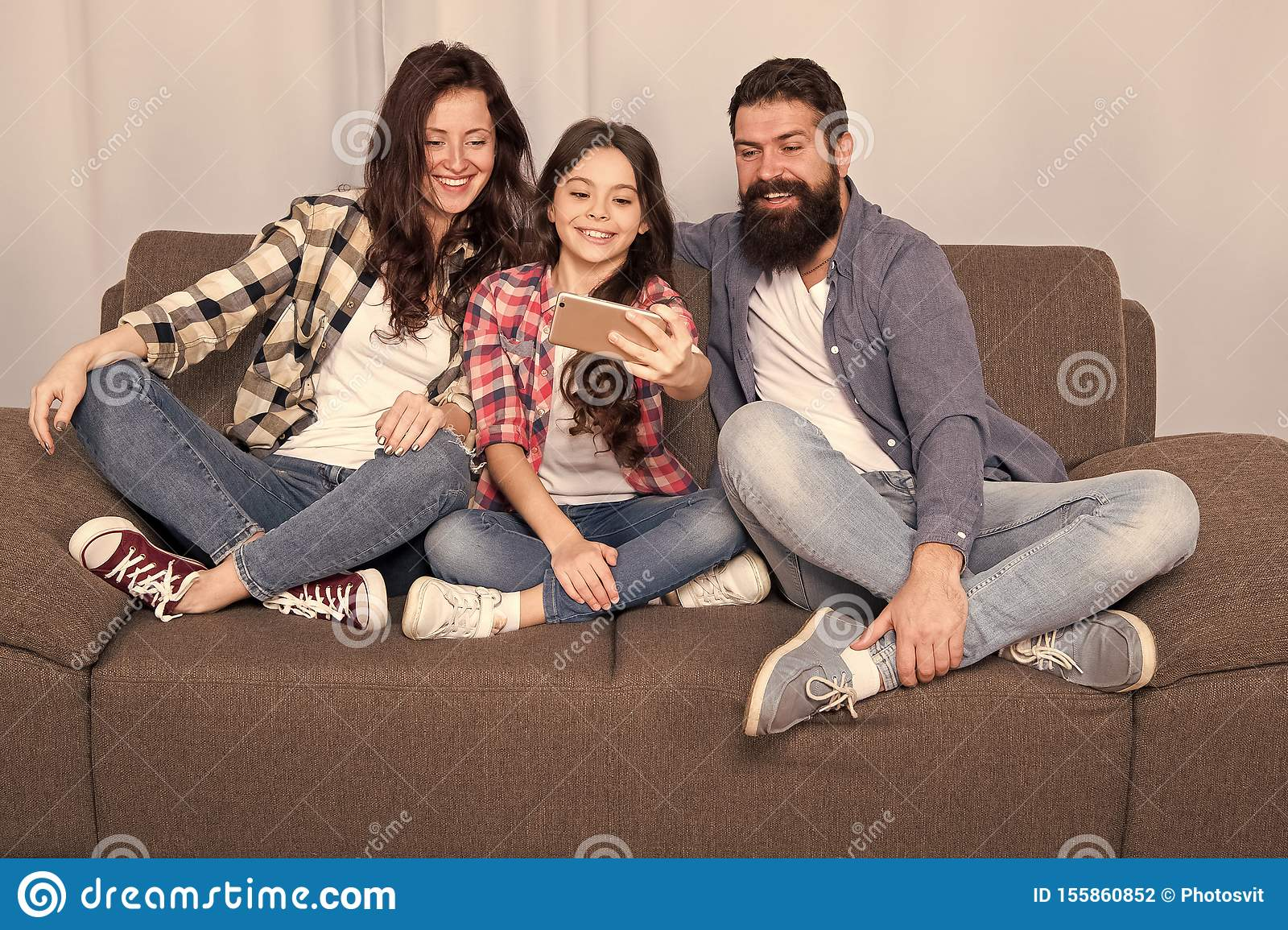 Capture happy moments. Family spend weekend together. Use smartphone for selfie. Friendly family having fun together