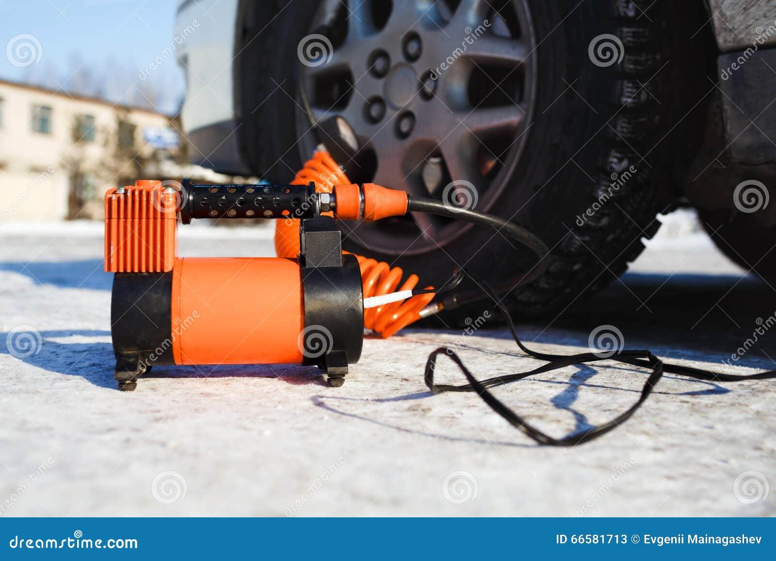 Air Compressor Car: Car Air Compressor In Working Position At Snow. Self
