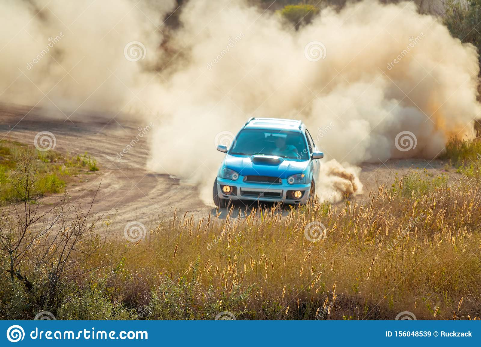 Car on the Bend of a Sunny Dusty Road