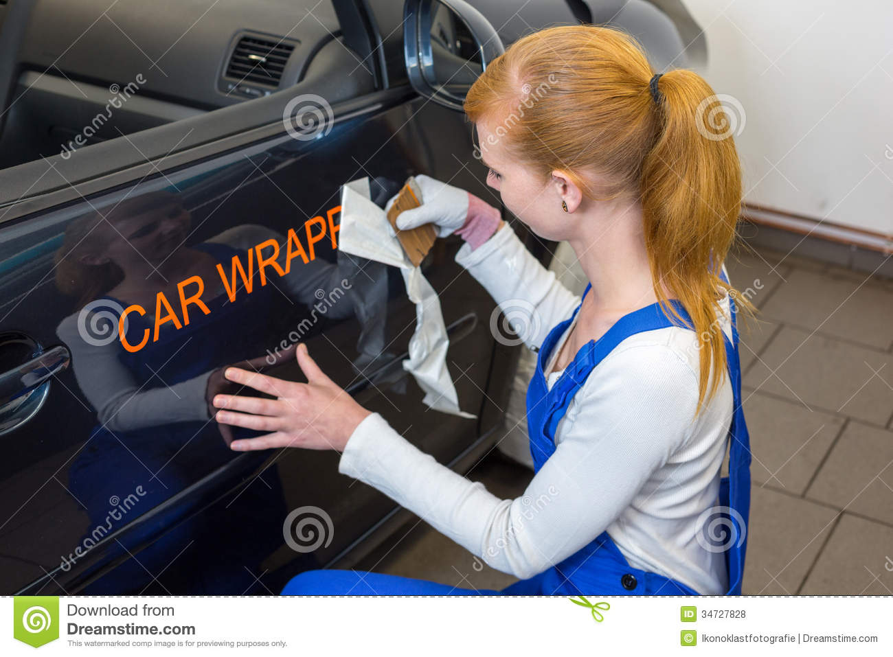 Car Branding Specialist Puts Logo With Car Wrapping Film On Automobile Stock Photo Image Of Garage Body 34727828