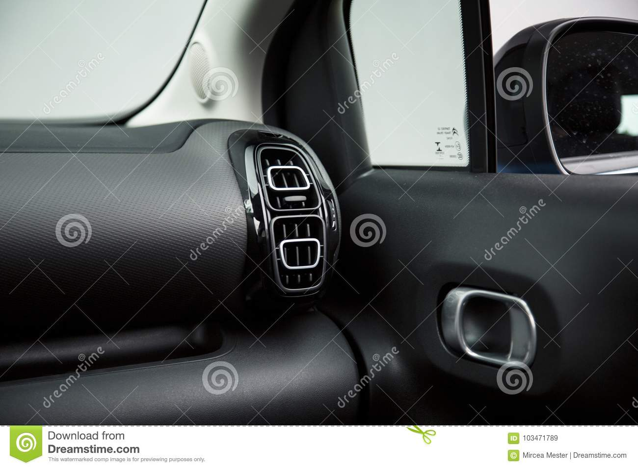 Car Interior: Modern Air Vents And Door Handle Stock Image