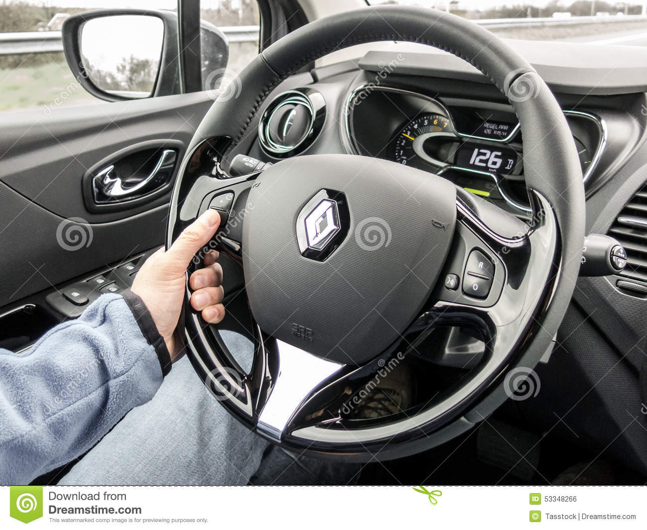 car driver hand on the wheel on cruise control driving editorial photo image 53348266. Black Bedroom Furniture Sets. Home Design Ideas