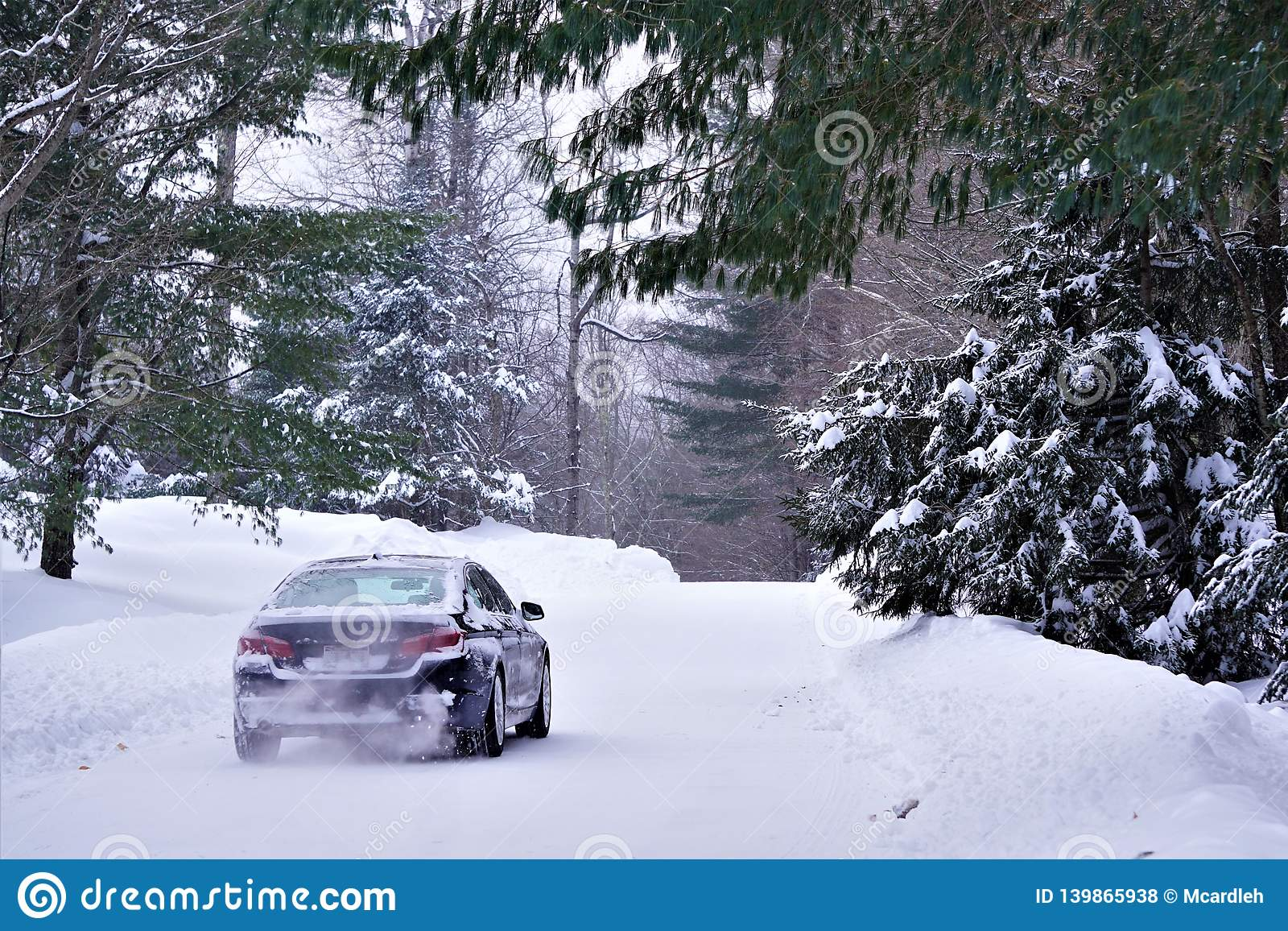 Car drives on snowy road