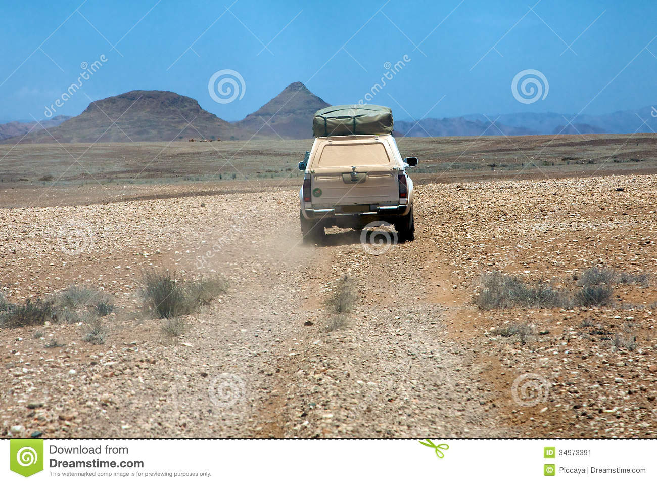 Car driving on a gravel road