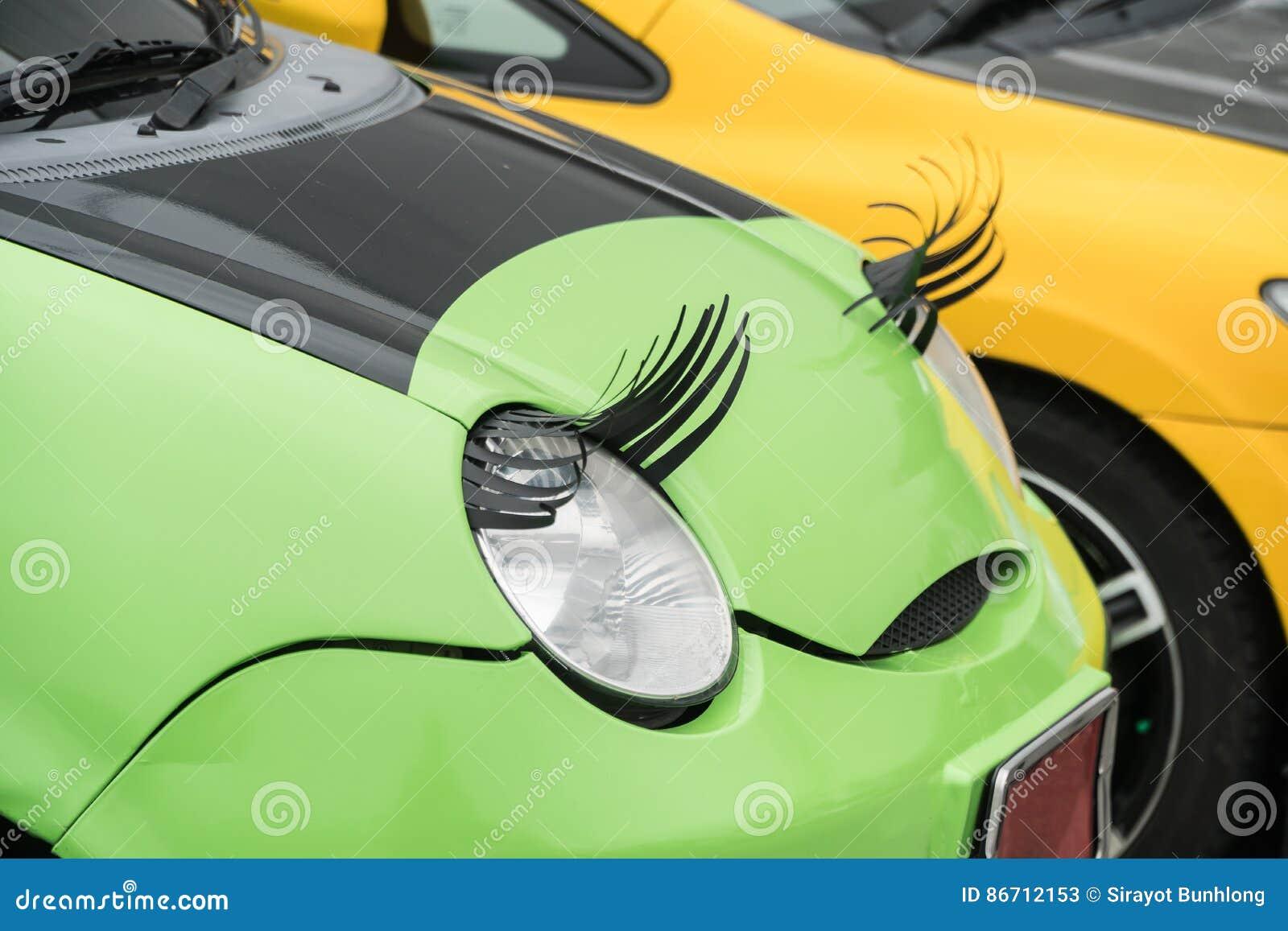 Car With Eyelashes On Headlightsas Feminine Symbol Stock Image