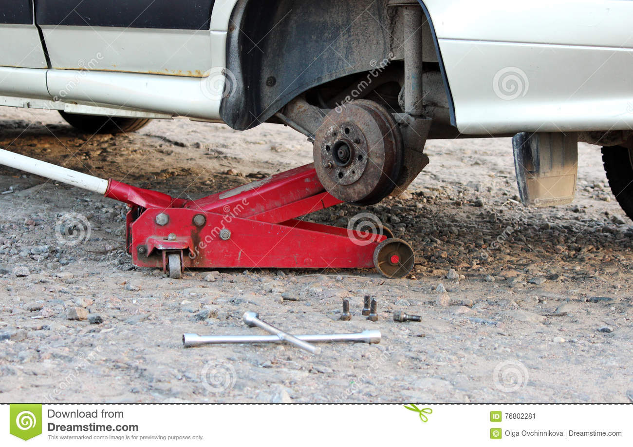 Car Fixed In The Garage Hydraulic Floor Jack Lift A Car Wheel