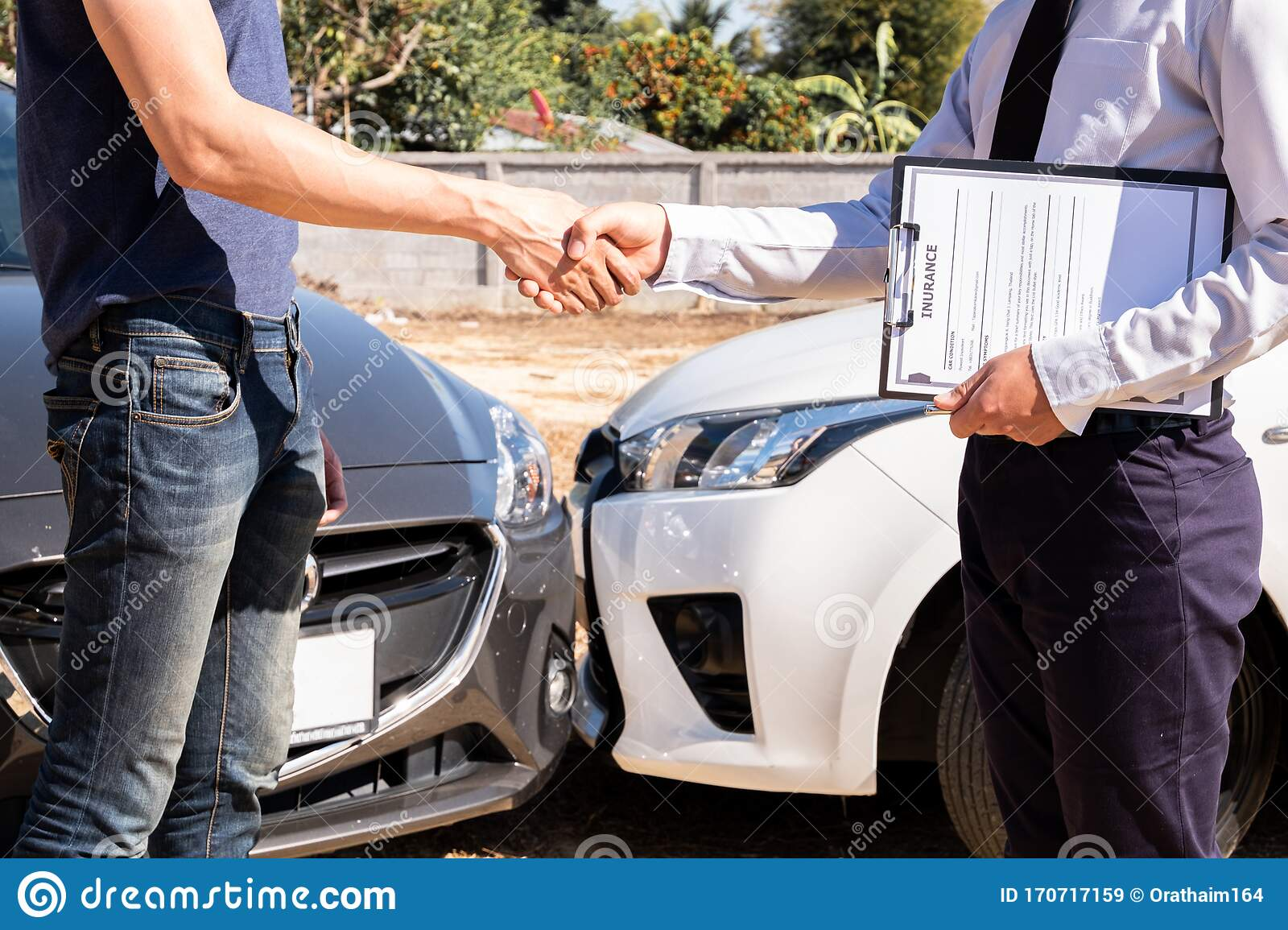 The Car Insurance Agent Is Checking The Accident Spot. Of ...