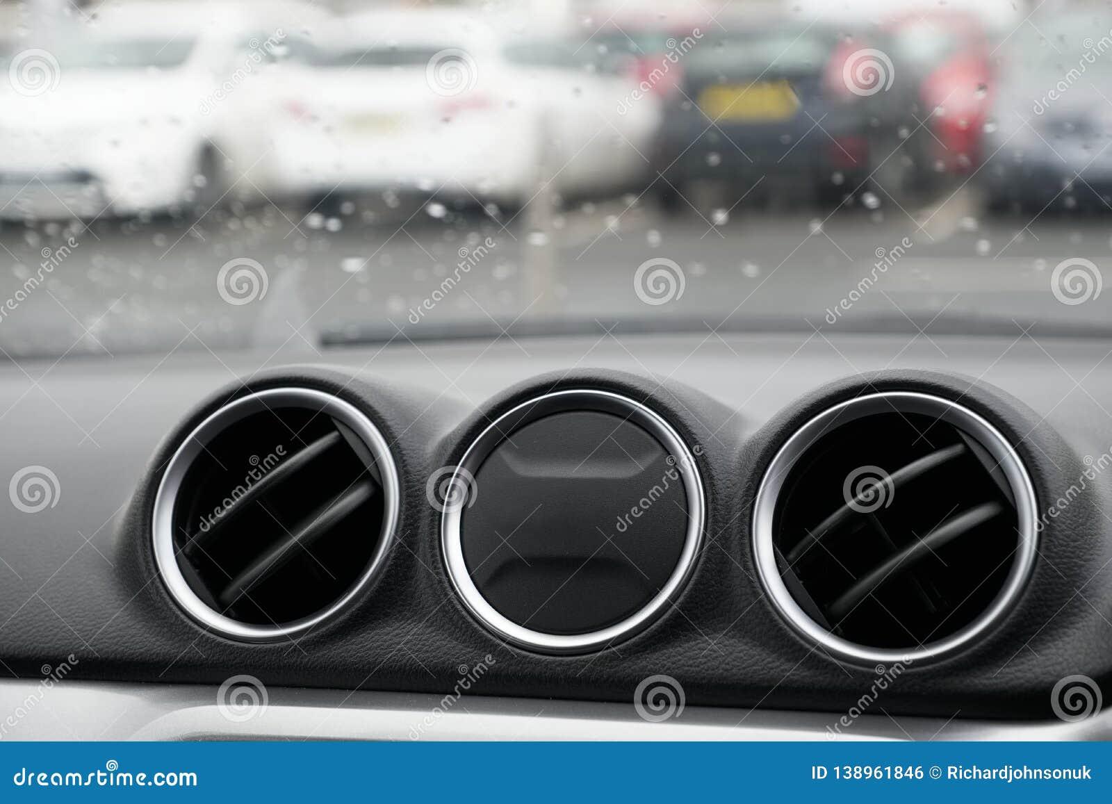 Car interior air vents three circular round on dashboard