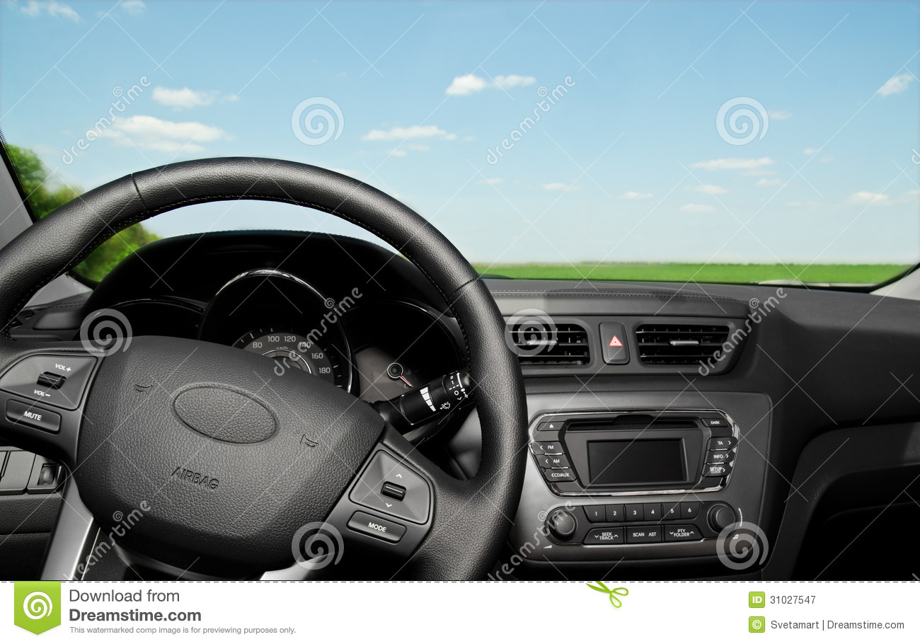Car Interior Control Panel And Wheel Royalty Free Stock