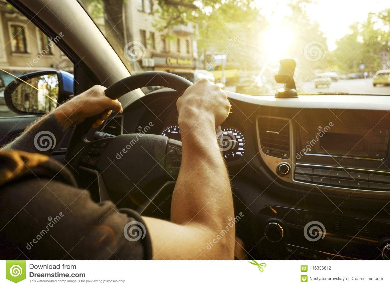 Car Interior With Male Driver Sitting Behind The Wheel, Soft