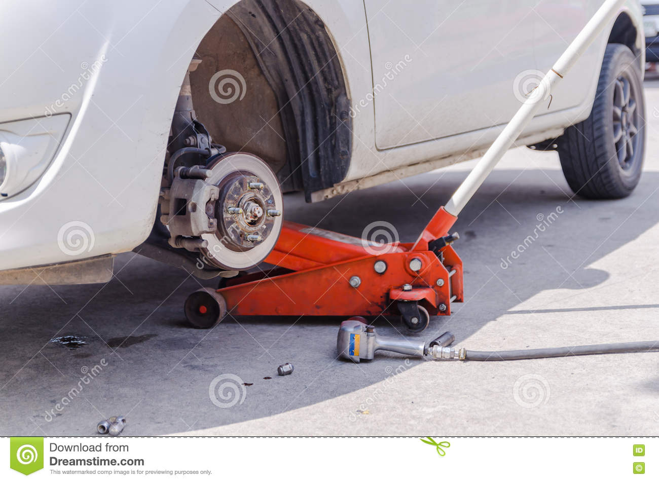 Car Jack To Lifting The Car For Replace Wheel And Repair At Garage