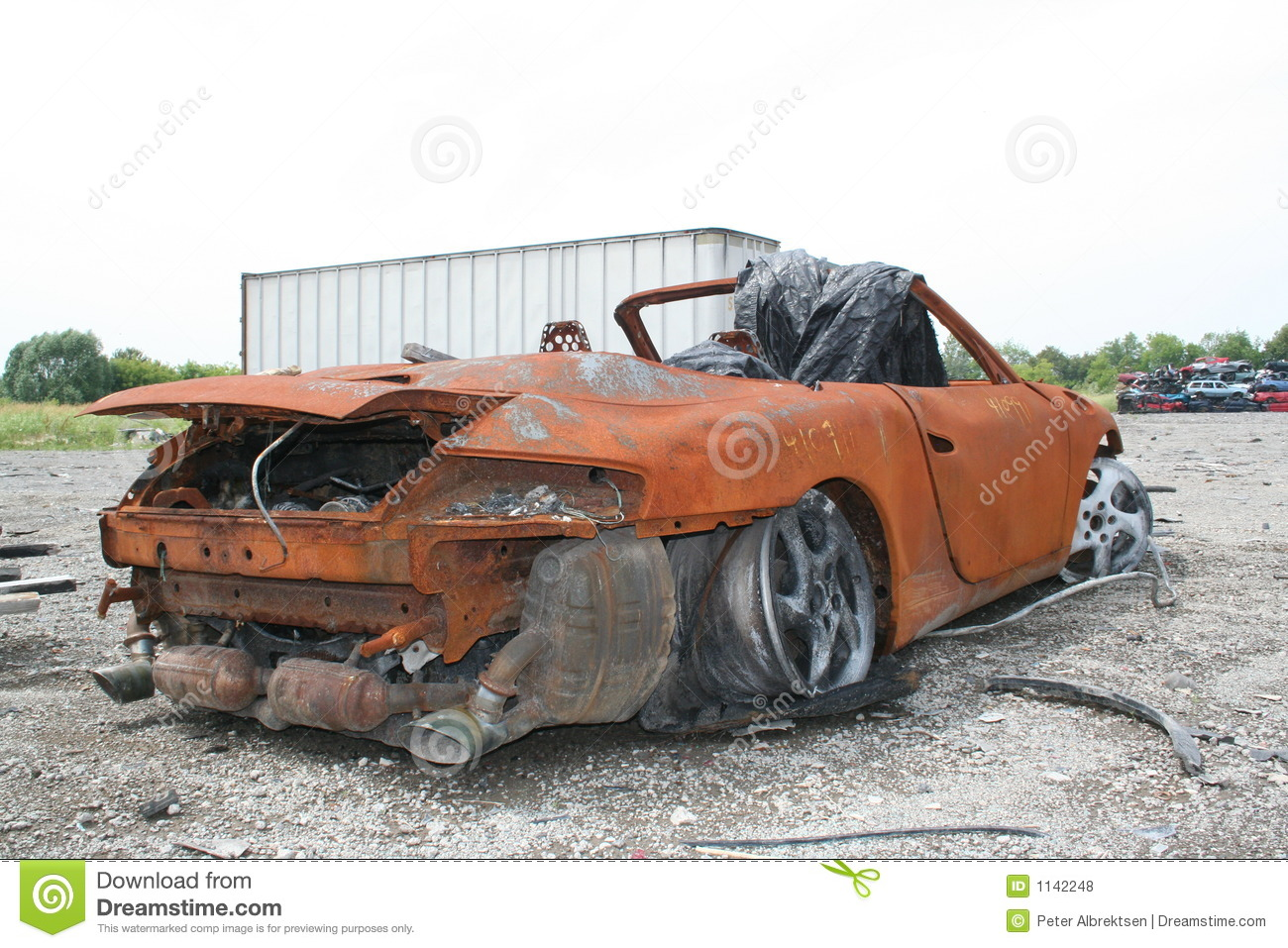 Car In A Junk Yard Royalty Free Stock Photos - Image: 1142248